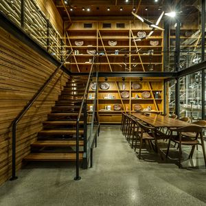 Starbucks Roastery in Seattle with wood stools and bar