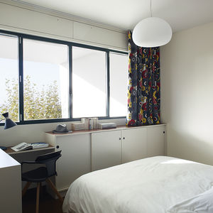 French bedroom with graphic curtains