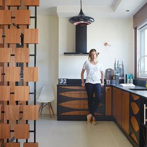 Interior designer Florence Deau in her modern kitchen filled with vintage finds in France