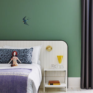 Guest room with green wall at the Drake Devonshire