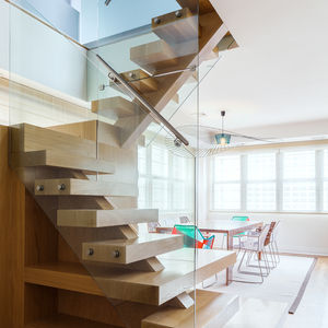 Wood and glass stair in a Tribeca penthouse