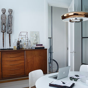 Amsterdam office with vintage teak dresser and glass doors
