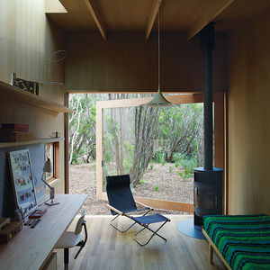 Australian studio with open glass door and wood-burning stove