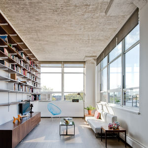 Brooklyn living room with a blue Acapulco chair