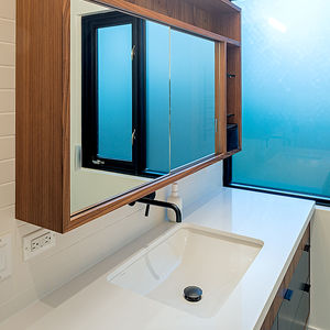 A black Brizo faucet in bathroom of Toronto renovation by Jenny Francis Design.
