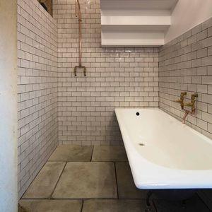 London bathroom with copper fixtures