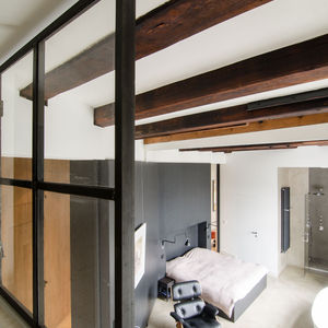Amsterdam loft with exposed ceiling beams.
