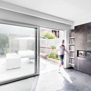 A 13-foot-wide sliding door opens a Montreal home to a garden