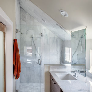 Carrara marble and Hansgrohe fixtures in bathroom of Denver home.