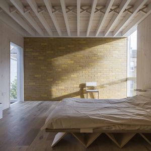 London bedroom with exposed beams.