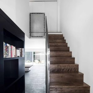 Staircase with adjacent bookshelves