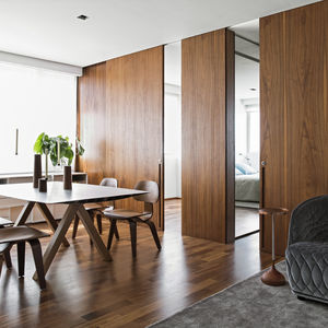 Dining room with Eames chairs and wood panels