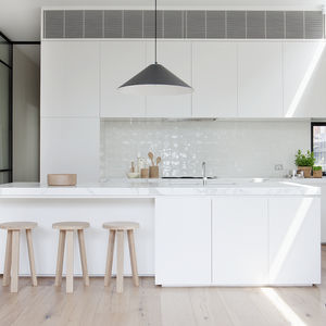 White honed Calacatta marble countertops with clerestory window in Melbourne renovation's kitchen.