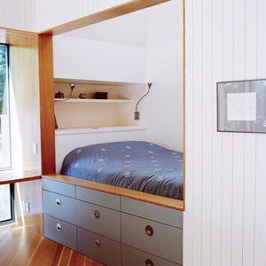 Modern small space Rhode Island cottage with sleeping nook and writing desk