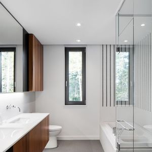 DuPont Zodiaq Quartz countertops and Duravit Starck 3 sink in bathroom of Quebec renovation by Naturehumaine.