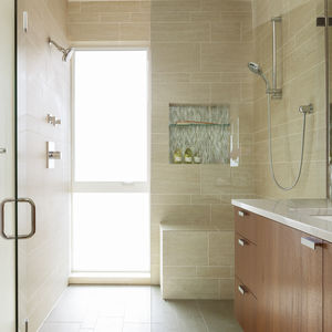 Master bathroom wrapped in Q-Stone tiles in Ice by Provenza.