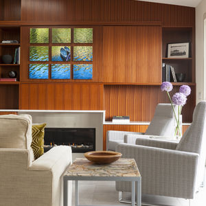 Living room with extensive sapele veneer and Dalton Recliners by Room & Board.