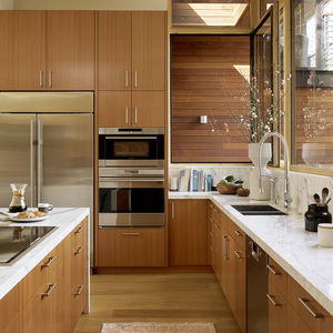 Wolf and Sub-Zero appliances in kitchen with custom cabinetry.