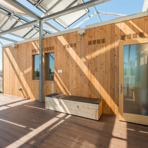 Canopy and trellis, with larch siding, of NY State University at Buffalo's Solar Decathlon design.