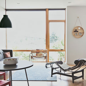 Modern multifamily home in Seattle with Wassily chair and Le Corbusier chaise in the living dining area