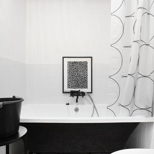 Kludi Bozz fixtures an IKEA shower curtain in Moscow bathroom.
