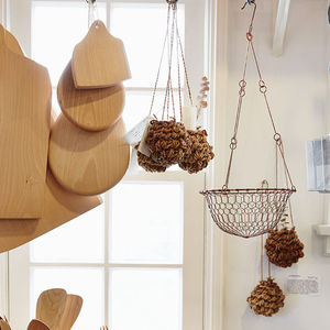 A corner of the store featuring baskets, cutting boards, and utensils.