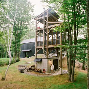 A three-story tree house features a sauna and screened-in dining room.
