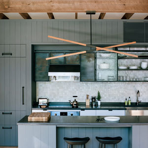 A custom light hangs over the island in this Hudson Valley kitchen.