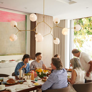 In the dining room, family and friends come together over a walnut-slab dining table.