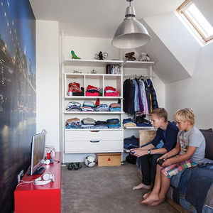 amsterdam canal house kid's bedroom with ikea goed bed and cityscape wall