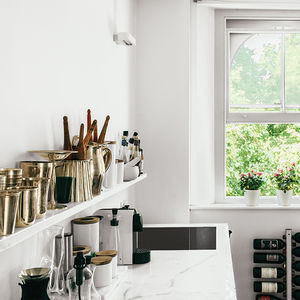 Tiny London apartment renovated kitchen with marble countertop sink and shelf by Staturario
