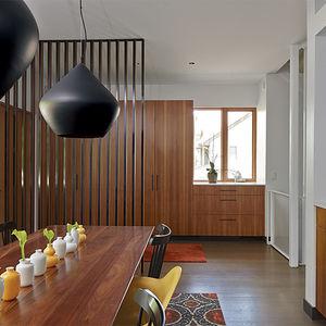 Kansas City dining room with Tom Dixon pendant lights and custom table