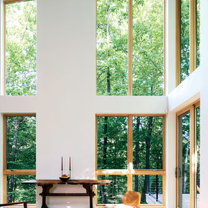 Modern small cantilevered cabin in Massachusetts with double height Marvin Integrity windows