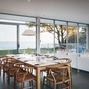 ontario vacation home dining area with custom dining table and carl hansen & søn pendant lamp
