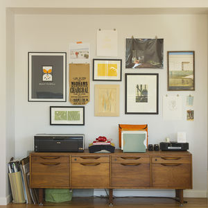 Office with secondhand filing cabinet and graphic artwork