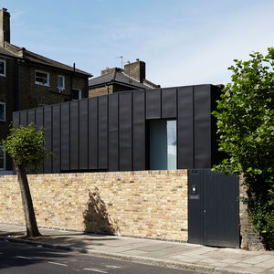 Passive house with a zinc paneled exterior