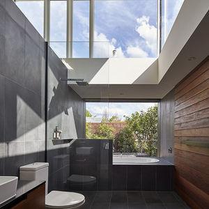 Caroma bath and Parisi toilet in modern bathroom.
