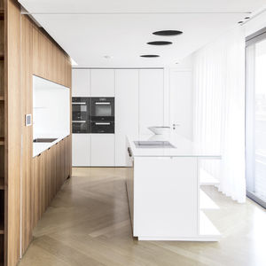 Berlin kitchen with walnut cabinets and a custom island