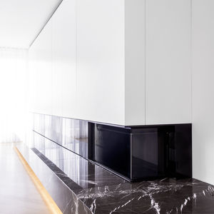 Custom cabinet above a marble fireplace