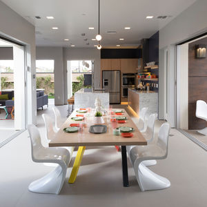 Millennial concept home with an indoor-outdoor dining area