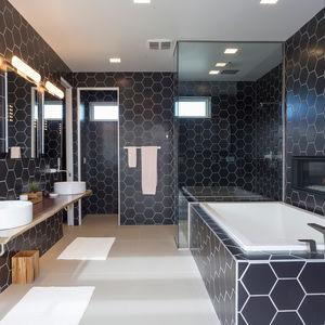 Millennial concept home with a black-tiled bathroom