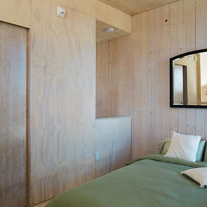 Modern prefab vacation home in Washington bedroom with just the basics