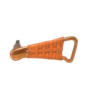 A leather-wrapped door handle by Alvar Aalto