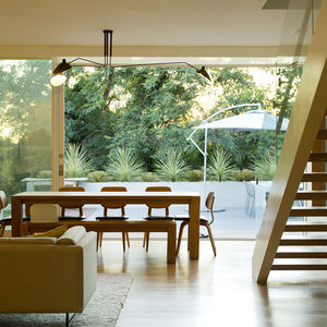 Indoor-outdoor dining room with a picnic-style table