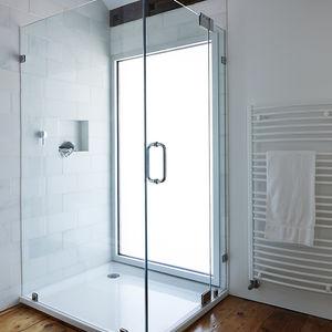 Modern glass shower in the Twisted Farmhouse bathroom
