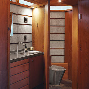 Modern home renovation in Napa includes redwood and concrete in the bathroom along with mgs faucet and foshan fully bao toilet