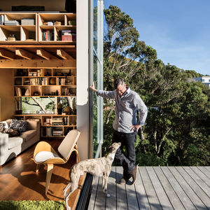 Modern small space in New Zealand with doors, deck, and passive insulation