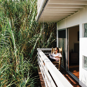 Modern Los Angeles renovation by Don Dimster with bedroom deck and Brumby rocking chair