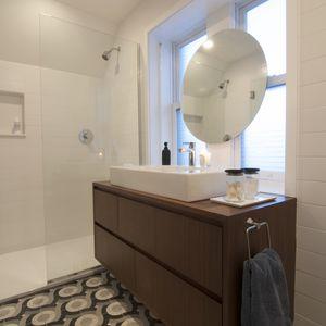 Custom patterned tiles in Chicago renovation's bathroom.