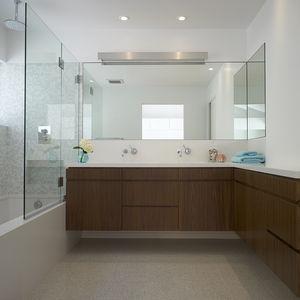 Zuma and Dornbracht showerhead in bathroom of Los Angeles renovation by Montalba Architects.
